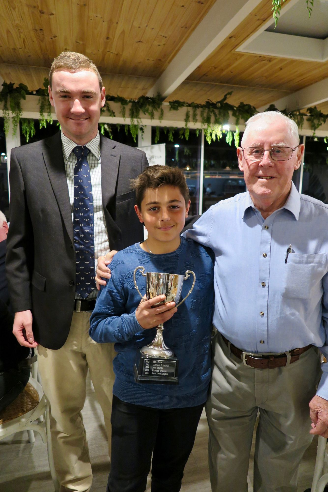 """Seb Natoli (8/ME) with the President of the South Sydney Rugby Referees Association Bill Mackay and David """"Paddy"""" Vaughan."""